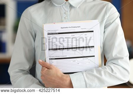 Businesswoman Holds Application Form Employment Document In Hands