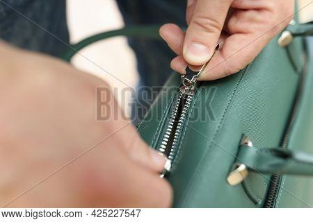 Male Hands Zip Up Green Leather Bag Closeup