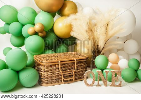 one year birthday studio setup with balloons and decorations