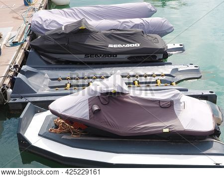 Russia, Sochi 06.06.2021. Jetskis And A Rib Boat Covered With Awnings Are Moored At The Pier In The