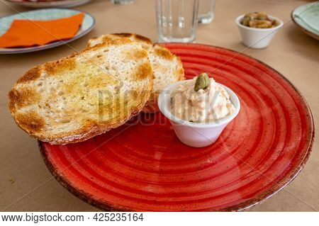 Toast With Cheese Sauce, A Typical Starter In A Greek Restaurant.