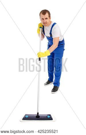 Professional Cleaning Service Concept - Full Length Portrait Of Man Cleaner In Blue Uniform Cleaning