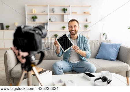 Positive Male Vlogger Recording Video Review Of Tablet Computer At Home, Mockup