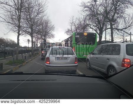 Road View Through Car Windshield, Cars On Road In Traffic In Bucharest, Romania, 2021