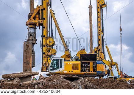 Hydraulic Drilling Rig Bauer Bg 36 On A Construction Site. Installation Of A Casing String To Create