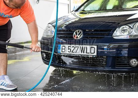 Washing And Cleaning Car In Self Service Car Wash Station. Car Washing Using High Pressure Water In