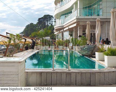 Russia, Sochi 06.06.2021. An Open-air Blue Pool In A Restaurant Hotel Complex On The Sochi Embankmen