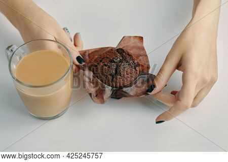 Womens Hands Unwrap Chocolate Muffin. Mug Of Coffee On White Table. Morning Romantic Breakfast. Coco