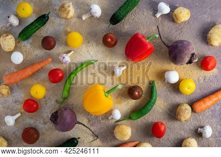 Flatlay From A Variety Of Fresh Vegetables On The Table. Healthy Food Concept.