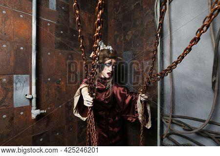 Aggressive stylish steampunk woman in a creative interior.