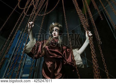 Young woman before a party or carnival. Bright creative makeup and hairstyle. Steampunk interior.