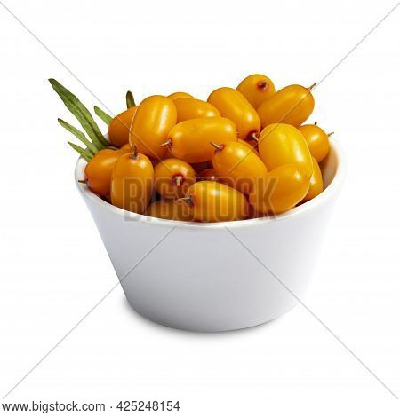 Ripe Sea Buckthorn Berries In A Ceramic Cup With Green Leaves On White Isolated
