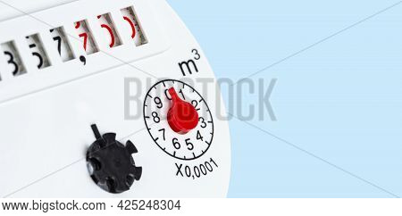 Water Meter Numeric Panel On Light Blue Background, Copy Space.