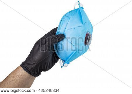 Respirator Ffp3 For Protection Against Viruses And Dust In The Hand Of A Man In A Black Glove On Whi