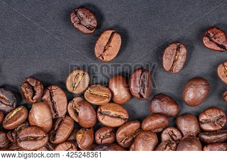 High Quality Roasted Coffee Beans On A Dark Background, Top View