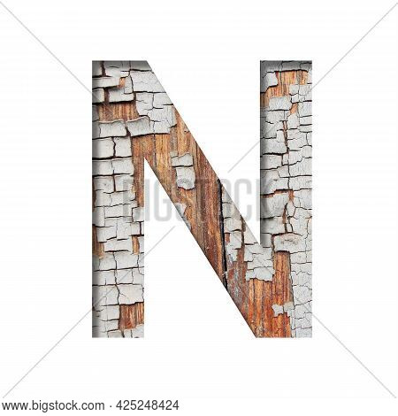 Vintage Backdrop Font.the Letter N Cut Out Of Paper Against The Background Of An Old Wooden Wall Wit