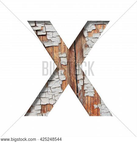 Vintage Backdrop Font.the Letter X Cut Out Of Paper Against The Background Of An Old Wooden Wall Wit