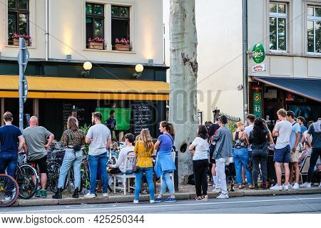 Leipzig, Germany - June 29, 2021: Fans Of The German National Football Team At The Pub In Leipzig Su