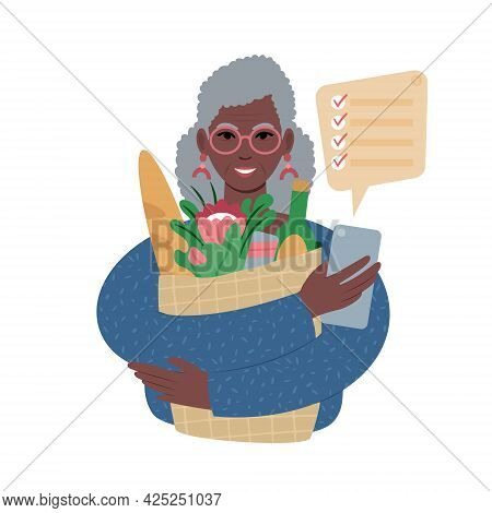 Senior African Woman With Groceries Bag And A Shopping List On A Smartphone.