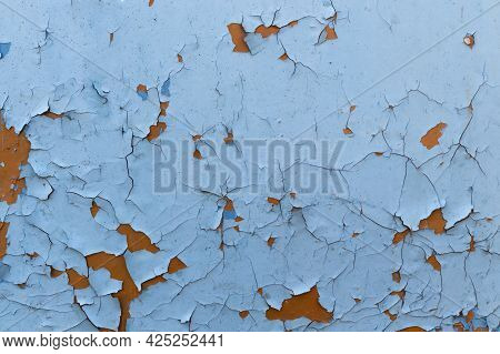 Old Painted Wall Texture As Grunge Background. Blue Wall With Peeled Paint Close Up. Color-peel Wood