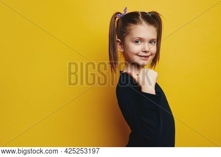 Photo Of Lovely Cute Girl Pointing Aside, Demonstrates Promo On Right, Looks With Interesting Expres