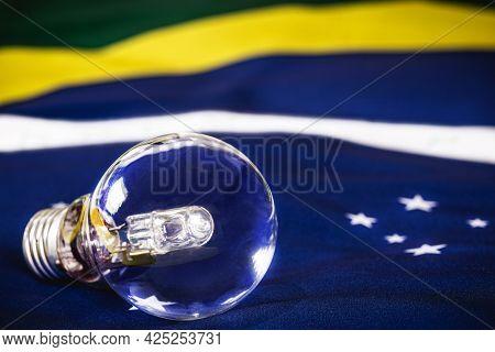 Extinguished Light Bulb Over The Brazilian Flag, Concept Of Brazilian Energy Crisis, Blackout Risk