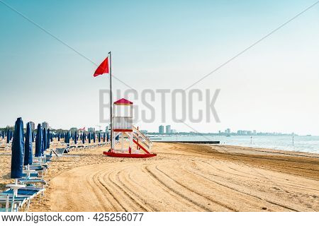 Beach At The Adriatic Sea Coastline In Italy, Europe During Summer. Traditional Hut For The Beach Li