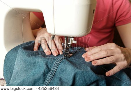 Women's Hand Working On Sewing Machine. Life At Home. Handmade, Authentic Lifestyle
