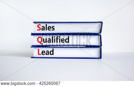 Sql Sales Qualified Lead Symbol. Books With Words 'sql Sales Qualified Lead'. Beautiful White Backgr