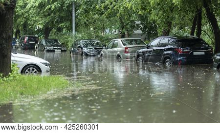 Flooded Cars On The Street Of The City. Street After Heavy Rain. Water Could Enter The Engine, Trans