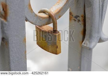 A Fragment Of The Lattice Of A Bridge On Which Rusty Wedding Locks Hang