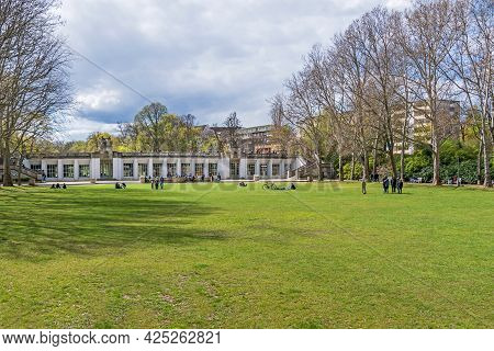Berlin, Germany - April 25, 2021: Playgrounds Of The Garden Monument Rudolph Wilde Park And The Arch