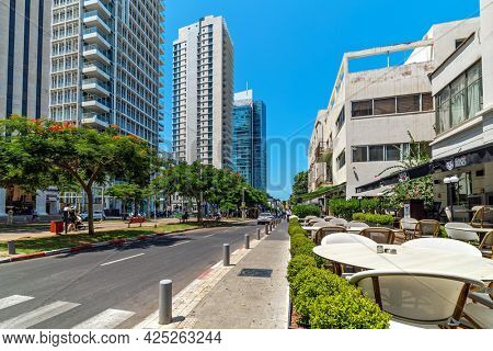 TEL AVIV, ISRAEL - JULY 18, 2018: High-rise residential buildings on Rothschild Boulevard - one of the principal and expensive streets in Tel Aviv, one of the city's main tourist attractions.