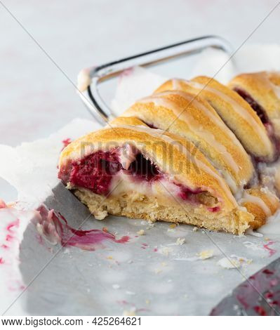 Close Up View Of A Portion Of A Raspberry Crescent Ring Taken From The Side Of It.