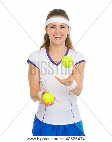 Happy Tennis Player Joggling With Tennis Balls