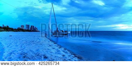 Night Sky Over Shipwreck On The Coast Of Clam Pass In Naples