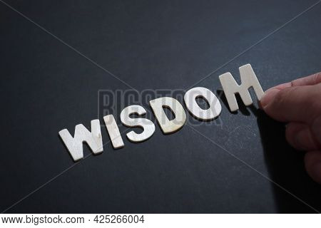 Wisdom, Text Words Typography Written With Wooden Letter On Black Background, Life And Business Moti