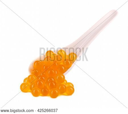 Yellow Tapioca Pearls For Bubble Tea Isolated On White Background. Tapioca Pearls In Ceramic Spoon.