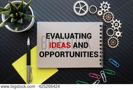 Evaluating Business Opportunities Word Printed On A Book. Business Concept.