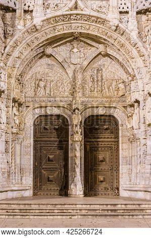 Manueline Style Facade Of The Tourist Jerónimos Monastery In The Lisbon Neighbourhood Called Belem