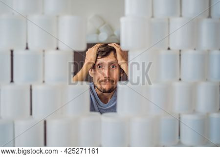 The Man Is Shocked By How Much Plastic He Used In A Year Surrounded By Many Jars Of Yoghurt That He