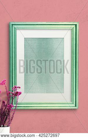 Green photo frame wall mockup