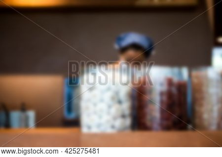 Blur Background Of Seller Action Of Cooking Papaya Salad Or Thai People Call