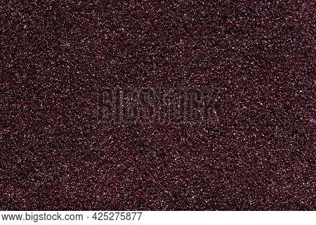 Dark purple glittery textured background