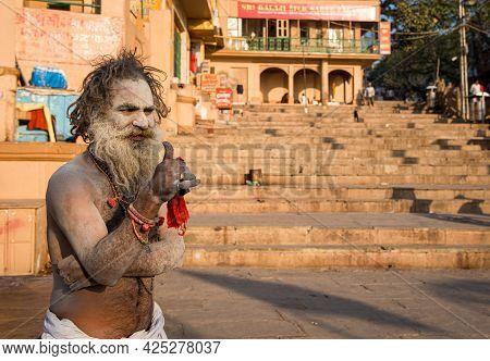 Varanasi, India, March 13 2017: Religious Hindu Monk With Painted White Face At Varanasi India, Asia