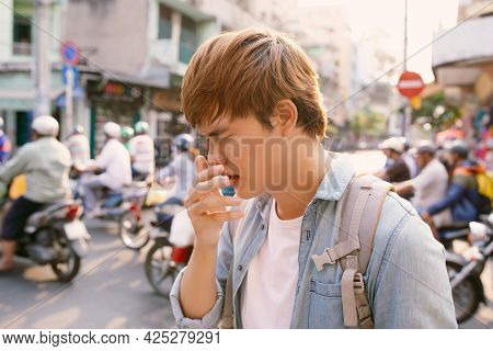 Man Sneezing On Street Because Bad Air Pollution,man Got Nose Allergy At Outdoor