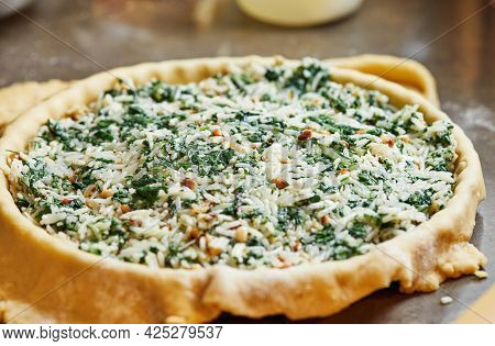 Filled Dough In Baking Dish With Swiss Chard. Step By Step Recipe