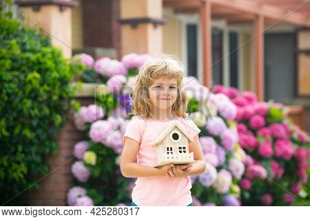 Toy House, Family Home. Real Estate Housing, Home Care, Family Day Care Concept. Happy Child Boy Dre
