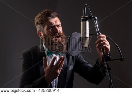 Handsome Man In Recording Studio. Music Performance Vocal. Music Festival. Singer Singing Song With