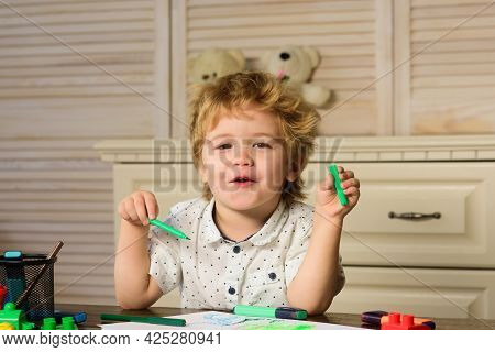 Cute Kid Playing With Toy In Playroom. Caucasian Child Portrait. Kid Playing With Colorful Blocks, F